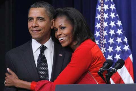 Vợ chồng Tổng thống Obama. Ảnh: AP